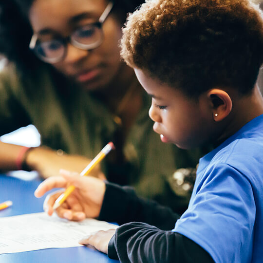 BGCMA teen serving as a homework helper